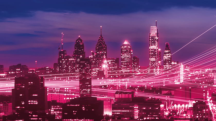 City skyscrapers with magenta lighting and white streaks passing through the middle