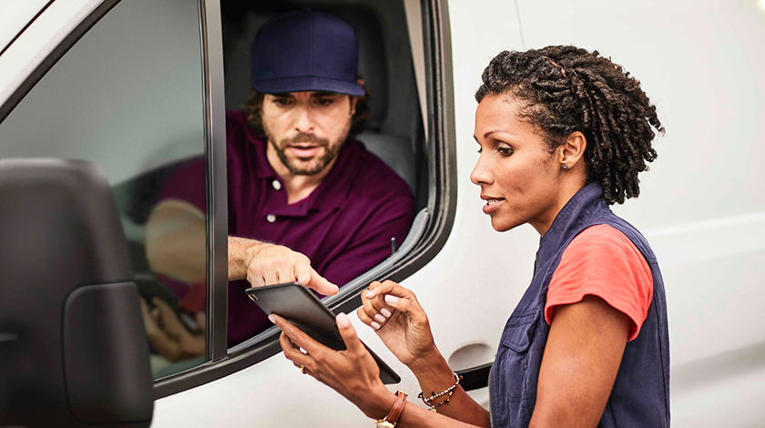 Woman holding tablet and talking with driver