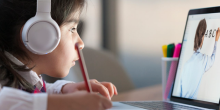 Young student attending online class.
