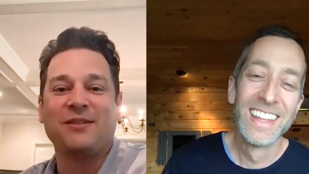 Split screen of a middle-aged man video chatting with a smiling middle-aged man at his home.