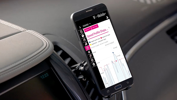Phone clipped to dashboard displaying Fleet Management