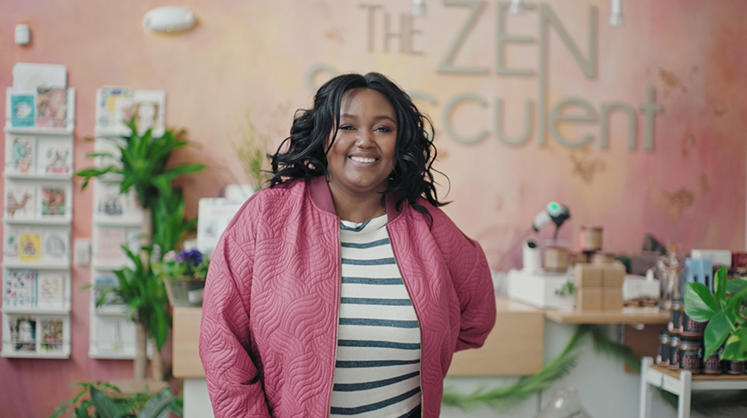 Image of The ZEN Succulent CEO, Megan Cain in her storefront.