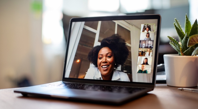 Woman in videoconference call on laptop
