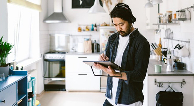 Man working on tablet in kitchen
