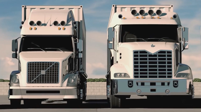 Two parked white trucks