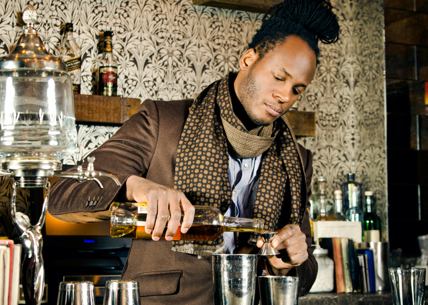 Karl Franz Williams mixes a craft cocktail at a bar