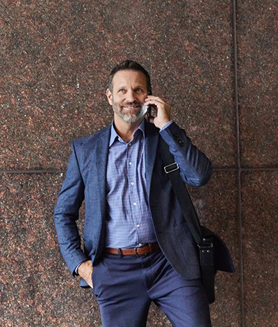 Man in blue suit talking on phone
