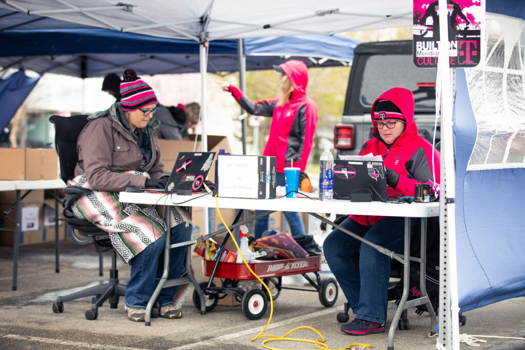 T-Mobile employees in Boise, Idaho organized curbside technology pickup so customer care teams can work from home during COVID-19 pandemic.
