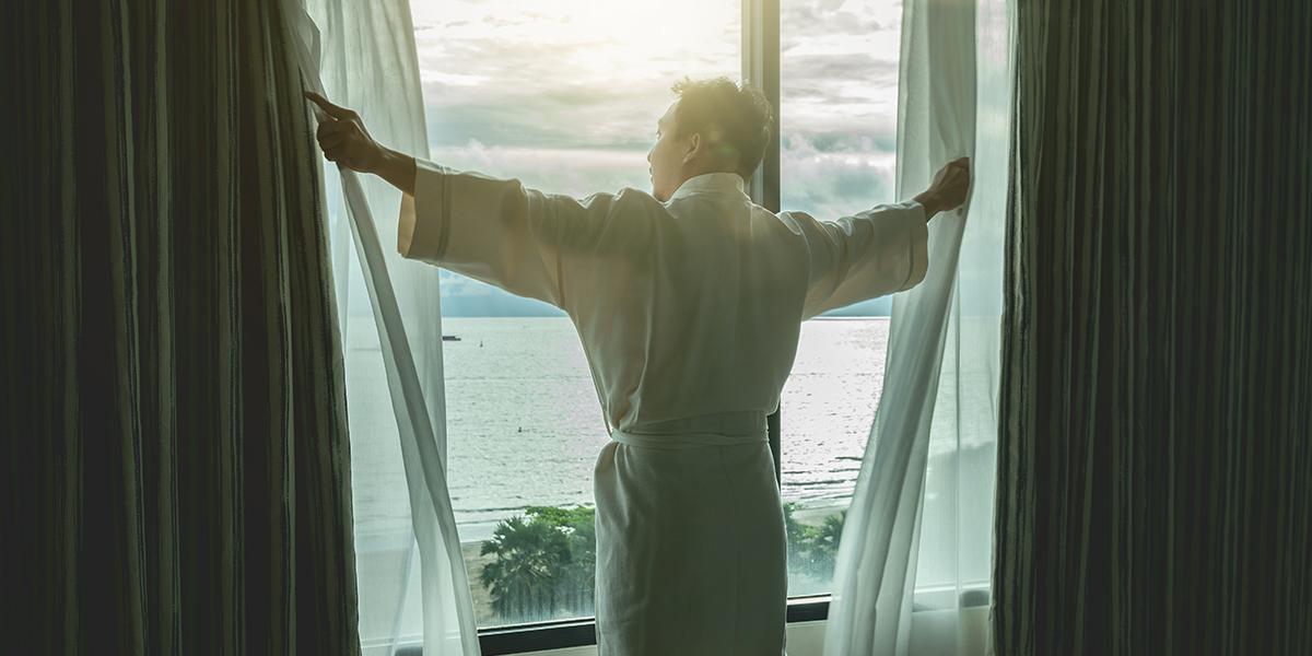 man opens window